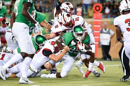 North Texas Mean Green running back Andrew Tucker (25) carries the ball for a first down during an NCAA Football game between the Lamar Cardinals and the North Texas Mean-Green Eagles at Apogee Stadium in Denton, Texas