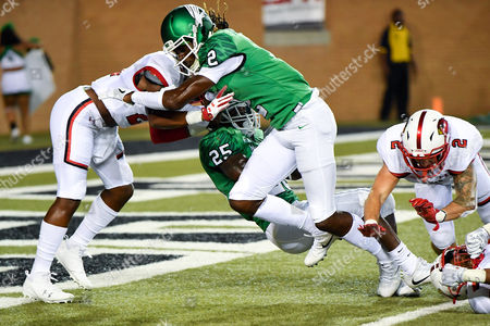 North Texas Mean Green running back Andrew Tucker (25) carries the ball for a touchdown as North Texas Mean Green wide receiver O'Keeron Rutherford (2) blocks during an NCAA Football game between the Lamar Cardinals and the North Texas Mean-Green Eagles at Apogee Stadium in Denton, Texas