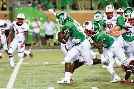 North Texas Mean Green running back Andrew Tucker (25) carries the ball for a touchdown during an NCAA Football game between the Lamar Cardinals and the North Texas Mean-Green Eagles at Apogee Stadium in Denton, Texas