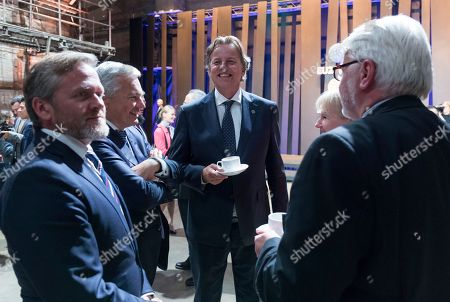 Dutch Foreign Minister Bert Koenders, center, smiles arriving for a group photo during the informal meeting of the EU foreign ministers in Tallinn, Estonia, on