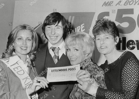 Anthony Boyle 18-year-old Supermarket Worker From Dundee Who Has Just Won Half A Million Pounds On Littlewoods Football Pools. He Is Pictured With Miss United Kingdom Carol Grant (left) And Actress Yootha Joyce (2nd Right). Box 724 31212167 A.jpg.