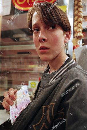 Stock Picture of Ep 2097 Thursday 11th July 1996 Having been threatened by Marcus and his gang, Scott is forced to steal from the post office, but all he can find is Betty's pension book - With Scott Windsor, as played by Toby Cockerell.