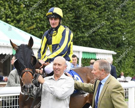 Winner of The Irish Yearling Sales Nursery  Stakes Move to the Front ridden by Adam Kelly is met in the winners enclosure by trainer Clive Cox   during Afternoon Racing at Salisbury Racecourse on 7th September 2017
