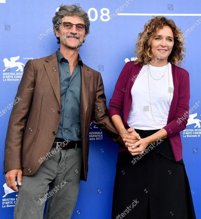 Italian director Silvio Soldini (L) and Italian actress Valeria Golino pose during a photocall for 'Il colore nascosto delle cose' at the 74th annual Venice International Film Festival, in Venice, Italy, 07 September 2017. The movie is presented out of competition at the festival running from 30 August to 09 September.