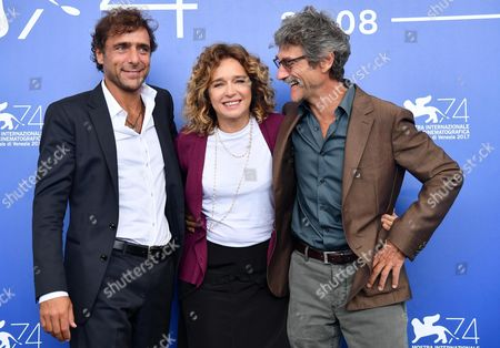 Italian director Silvio Soldini (R) with Italian actors Adriano Giannini (L) and Valeria Golino pose during a photocall for 'Il colore nascosto delle cose' at the 74th annual Venice International Film Festival, in Venice, Italy, 07 September 2017. The movie is presented out of competition at the festival running from 30 August to 09 September.
