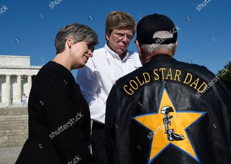 """Senator Joni Ernst, R-Iowa, left, and Bill Williams, center, talk to Gold Star dad Lonnie Ford, at """"Remembering Our Fallen,"""" a memorial exhibit that features photos of all who have died since Sept. 11, 2001, while wearing a uniform, at the Lincoln Memorial in Washington, . Mr. Ford's late son Sgt. Joshua A. Ford with the 189th National Guard Transportation Company, was killed by an IED in Iraq in 2006"""