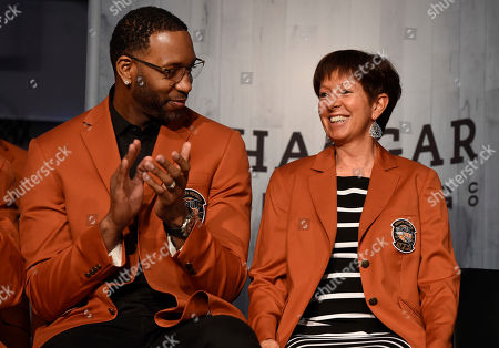 2017 class of inductees into the Basketball Hall of Fame Tracy McGrady, left, and Muffet McGraw, smile as they sit together during a news conference at the Naismith Memorial Basketball Hall of Fame, in Springfield, Mass