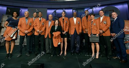 John Doleva, Nick Galis, Robert Hughes, Mannie Jackson, Tom Jernstedt, Thelma Krause, Rebecca Lobo, George McGinnis, Tracy McGrady, Muffet McGraw, Bill Self. Basketball Hall of Fame inductees from the left, Lauren Meyers, accepting on behalf of her late great uncle Zack Clayton, Nick Galis, Robert Hughes, Mannie Jackson, Tom Jernstedt, Thelma Krause, accepting on behalf her late husband Jerry Krause, Rebecca Lobo, George McGinnis, Tracy McGrady, Muffet McGraw, Bill Self, and Naismith Hall of Fame President and CEO John Doleva pose for a group photo at the end of a news conference at the Naismith Memorial Basketball Hall of Fame, in Springfield, Mass