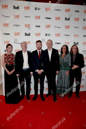 "Esther Yoo, Ian McEwan, Billy Howle, Dominic Cooke, Elizabeth Karlsen, Stephen Woolley. Esther Yoo, from left, Ian McEwan, Billy Howle, Dominic Cooke, Elizabeth Karlsen and Stephen Woolley attend the premiere of ""On Chesil Beach"" on day 1 of the Toronto International Film Festival at the Winter Garden Theatre, in Toronto"