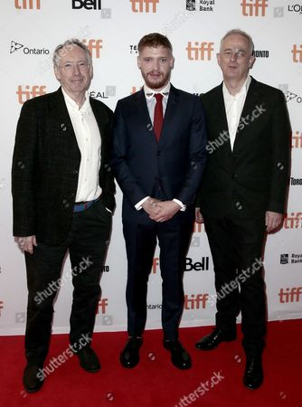 "Ian McEwan, Billy Howle, Dominic Cooke. Ian McEwan, from left, Billy Howle and Dominic Cooke attend the premiere of ""On Chesil Beach"" on day 1 of the Toronto International Film Festival at the Winter Garden Theatre, in Toronto"