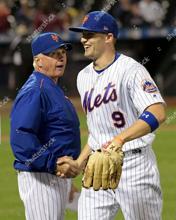 Brandon Nimmo, Terry Collins. New York Mets' Brandon Nimmo (9) celebrates with manager Terry Collins after they defeated the Cincinnati Reds in a baseball game, in New York