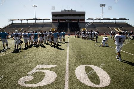 Members of the Kingwood High School football team practice, at Turner Stadium in Humble, Texas. The team's home field was destroyed as a result of Hurricane Harvey. Damage from Hurricane Harvey to their school forced the Kingwood team to practice 9 miles away at another high school and its students will attend classes at still another school in the days to come