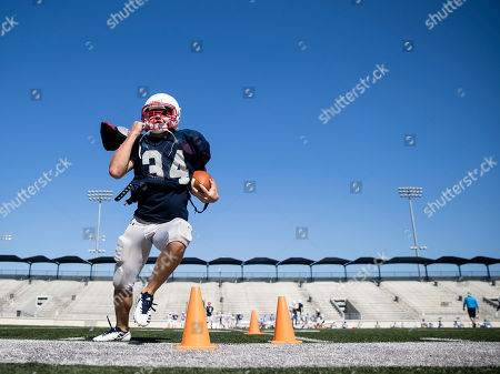 Kingwood High School football team member Aaron Finch runs a drill during practice, at Turner Stadium in Humble, Texas. Damage from Hurricane Harvey to their school forced the Kingwood team to practice 9 miles away at another high school and its students will attend classes at still another school in the days to come