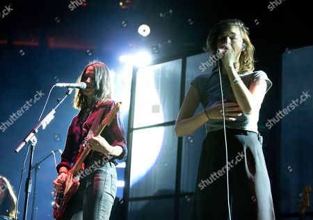 """Theresa Wayman, Emily Kokal. Theresa Wayman, left, and Emily Kokal of the band Warpaint perform in concert as the opening act for Depeche Mode during their """"Global Spirit Tour"""" at the Capital One Arena, in Washington, D.C"""
