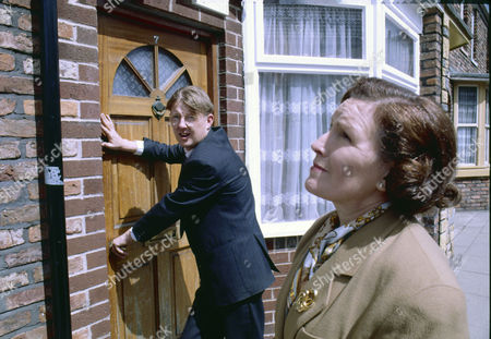 Stock Picture of Kevin Kennedy (as Curly Watts) and Marlene Sidaway (as Brenda Taylor)