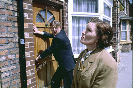 Kevin Kennedy (as Curly Watts) and Marlene Sidaway (as Brenda Taylor)