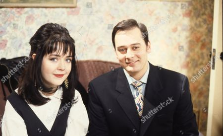 Caroline Milmoe (as Lisa Duckworth) and Nigel Pivaro (as Terry Duckworth)
