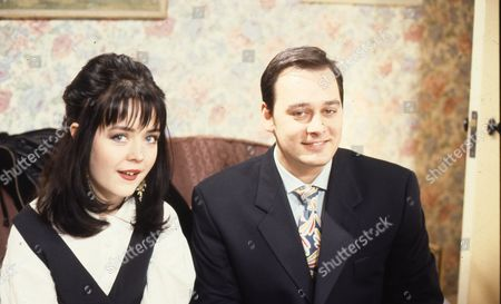 Stock Image of Caroline Milmoe (as Lisa Duckworth) and Nigel Pivaro (as Terry Duckworth)