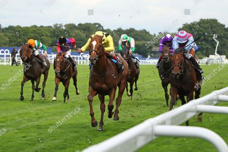 CAPE BYRON (yellow) ridden by Andrea Atzeni beating Fire Brigade (right) in The Leo Bancroft Signature Hair Care Classified Stakes at Ascot