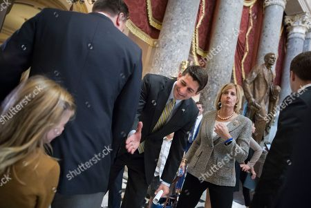Paul Ryan, Evie Johnson, Richard Hudson. Speaker of the House Paul Ryan, R-Wis., center, bends down to greet bashful 7-year-old Evie Johnson of Charlotte, N.C., as she hides behind Rep. Richard Hudson, R-N.C., left, during a visit to the Capitol with her mother Chandra Johnson, in Washington, . Ryan was returning to office after the House overwhelmingly passed a $15.3 billion disaster aid package to send to President Donald Trump, overcoming conservative objections to linking the emergency legislation to a temporary increase in America's borrowing authority