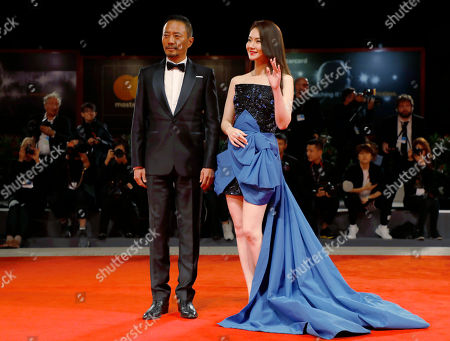 Stock Image of Actress Qi Wei and actor Zhang Hanyu arrive for the premiere of 'Zhuibu' (Manhunt), presented at the 74th annual Venice International Film Festival, in Venice, Italy