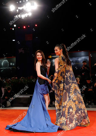 Actress Qi Wei and Tao Okamoto arrive for the premiere of 'Zhuibu' (Manhunt), presented at the 74th annual Venice International Film Festival, in Venice, Italy