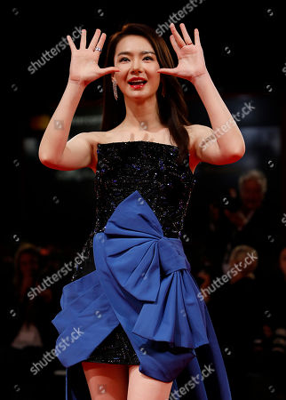 Actress Qi Wei arrives for the premiere of 'Zhuibu' (Manhunt), presented at the 74th annual Venice International Film Festival, in Venice, Italy