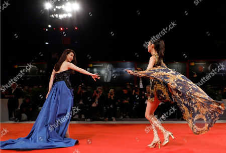 Qi Wei and Tao Okamoto arrive for the premiere of 'Zhuibu' (Manhunt), presented at the 74th annual Venice International Film Festival, in Venice, Italy