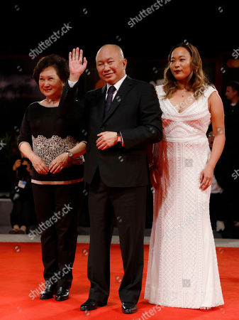 Annie Woo Ngau Chun-lung, John Woo and Angeles Woo arrive for the premiere of 'Zhuibu' (Manhunt), presented at the 74th annual Venice International Film Festival, in Venice, Italy