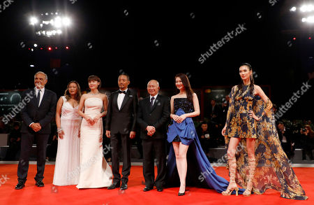Stock Picture of From left, festival director Alberto Barbera, Angeles Woo, Ha Ji-Won, Zhang Hanyu, John Woo, Qi Wei and Tao Okamoto pose for photographers as they arrive for the premiere of 'Zhuibu' (Manhunt), presented at the 74th annual Venice International Film Festival, in Venice, Italy