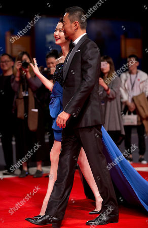 """Qi Wei, Zhang Hanyu. Actors Qi Wei, left, and Zhang Hanyu pose for photographers at the premiere for the film """"Zhuibu"""" (Manhunt) at the 74th edition of the Venice Film Festival in Venice, Italy"""