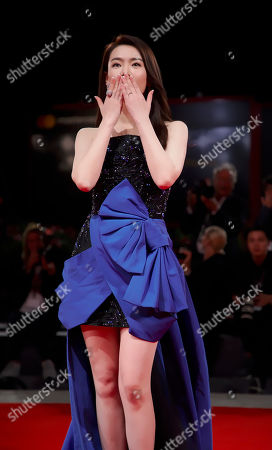 """Actress Qi Wei poses for photographers at the premiere for the film """"Zhuibu"""" (Manhunt) at the 74th edition of the Venice Film Festival in Venice, Italy"""