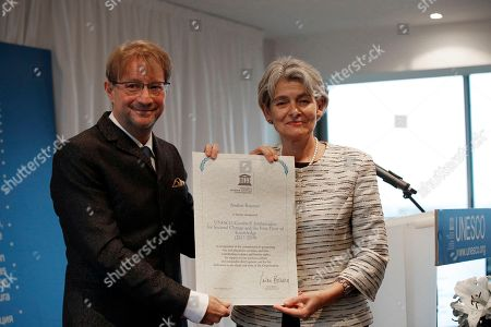 Mexican writer Andres Roemer poses with Director-General of UNESCO, Irina Bokova after being named UNESCO Goodwill Ambassador at the Organization's Headquarters in Paris