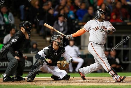 Pablo Sandoval, Kevan Smith, Gabe Morales. San Francisco Giants third baseman Pablo Sandoval, right, watches his three-run home run with Chicago White Sox catcher Kevan Smith, center, and umpire Gabe Morales (47) during the fourth inning of a baseball game in Chicago