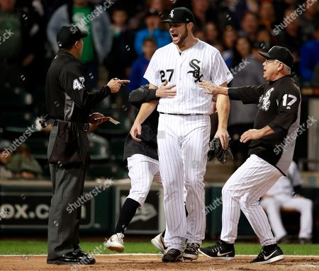 Stock Image of Lucas Giolito, Gabe Morales, Rick Renteria. Chicago White Sox starting pitcher Lucas Giolito (27) argues with umpire Gabe Morales (47) as manager Rick Renteria (17) holds him back after being thrown out of a baeball game by Morales during the sixth inning of a baseball game against the San Francisco Giants in Chicago, on