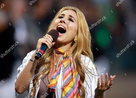 Haley Reinhart performs the national anthem before a baseball game between the Chicago White Sox and the San Francisco Giants in Chicago