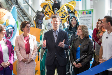 Hasbro Chairman and CEO Brian Goldner, center, speaks at the ribbon cutting ceremony for HASCON, the first-ever FANmily? event from Hasbro, Inc., on in Providence, R.I