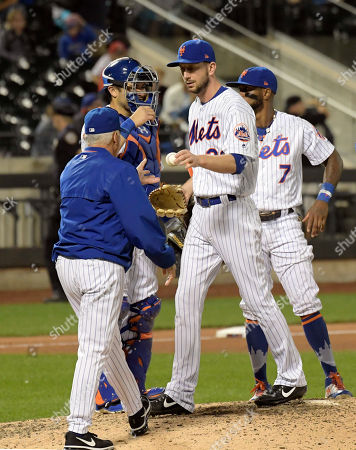 Jerry Blevins, Terry Collins. New York Mets pitcher Jerry Blevins hands the ball to manager Terry Collins, left, as he leaves the game during the ninth inning of a baseball game against the Cincinnati Reds, in New York
