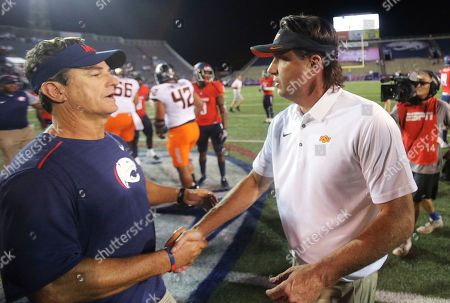 Joey Jones, Mike Gundy. South Alabama coach Joey Jones, left, shakes hands with Oklahoma State coach Mike Gundy after an NCAA college football game, in Mobile, Ala. Oklahoma State won 44-7