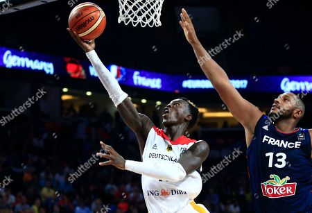 Germany's Dennis Schroder, left, jumps to score a basket as France's Boris Diaw tries to stop him during their Eurobasket European Basketball Championship round of 16 match in Istanbul, Saturday, Sept. 9. 2017