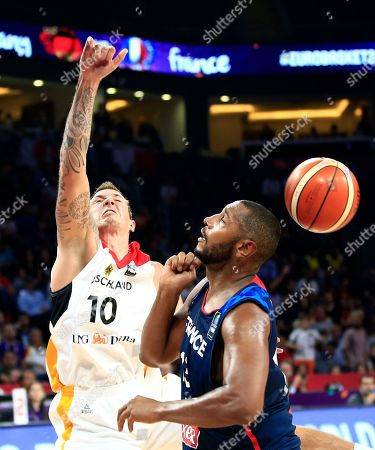 Germany's Daniel Theis, left, jumps for a lost ball as France's Boris Diaw tries to block him during their Eurobasket European Basketball Championship round of 16 match in Istanbul, Saturday, Sept. 9. 2017