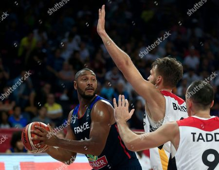 France's Boris Diaw, left, drives to the basket as Germany's Karsten Tadda, right, and Danilo Barthel trie to block him during their Eurobasket European Basketball Championship round of 16 match in Istanbul, Saturday, Sept. 9. 2017