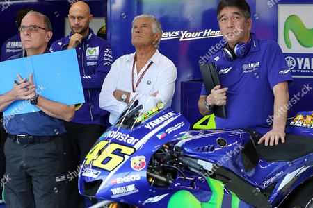 Italian former motorcycle road racer  Giacomo Agostini (C) in the box of Italian MotoGp rider Valetino Rossi of Yamaha Movistar during a free practice session of the motorcycling Grand Prix of San Marino and Riviera of Rimini at Misano circuit, in Misano Adriatico, Italy, 09 September 2017.