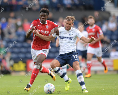 Stock Image of Tommy Spurr of Preston North End (right) fends off Ike Ugbo of Barnsley