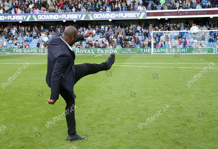 Danny Shittu kicks a ball into the net during the celebrations marking 100 years of Queens Park Rangers FC playing at  Loftus Road. The club invited 23 members of the Forever Rs club to celebrate on the pitch at halftime during the match between QPR and Ipswich Town, Sky Bet Championship match at Loftus Road, London, UK, 9 September 2017