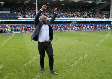 Stock Image of Danny Shittu waves to the crowd during the celebrations marking 100 years of Queens Park Rangers FC playing at  Loftus Road. The club invited 23 members of the Forever Rs club to celebrate on the pitch at halftime during the match between QPR and Ipswich Town, Sky Bet Championship match at Loftus Road, London, UK, 9 September 2017