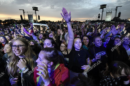 Fans react to the performance of German rapper Marteria (not pictured) at the Lollapalooza Festival in Hoppegarten near Berlin, Germany, 09 September 2017 (issued 10 September 2017). The event runs from 09 until 10 September.