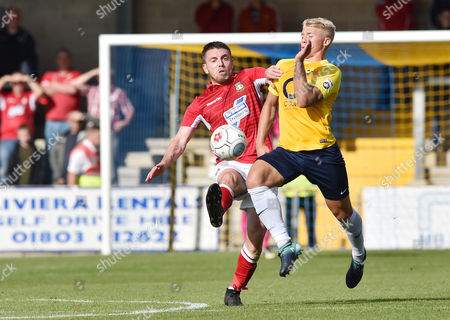 George Dowling of Torquay United battles for the ball with Paul Rutherford of Wrexham, during the Vanarama National League match between Torquay United and Wrexham at Plainmoor, Torquay, Devon on September 09