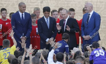 Former French soccer player David Trezeguet and (L), former Brazilian soccer player Bebeto (2nd-L), Russian President Vladimir Putin (C) and FIFA President Gianni Infantino (R) attend the FIFA World Cup Trophy Tour kick-off ceremony at the Luzhniki Stadium in Moscow, Russia, 09 September 2017. The Original Trophy will travel through 24 Russian cities and visit more than 50 countries around the World.