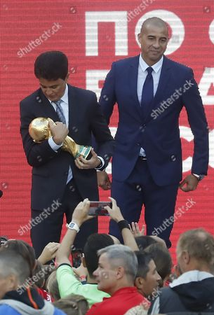 Former Brazilian soccer player Bebeto (L) and former French soccer player David Trezeguet (R) pose with the trophy at the FIFA World Cup Trophy Tour kick-off ceremony at the Luzhniki Stadium in Moscow, Russia, 09 September 2017. The Original Trophy will travel through 24 Russian cities and visit more than 50 countries around the World.